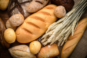 Loaves of bread with wheat stalk